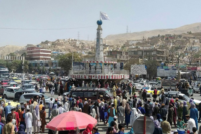 A Taliban flag on a plinth in the main cit square of Puli Khumri