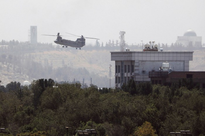 A US Chinook helicopter flies near the US embassy in Kabul on Sunday