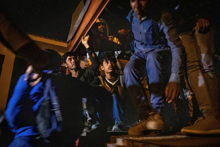 Afghan migrants leaving a truck in Van, Turkey