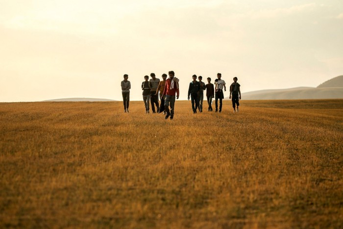 Young men who say they deserted the Afghan military and fled to Turkey through Iran walking in Bitlis Province in eastern Turkey