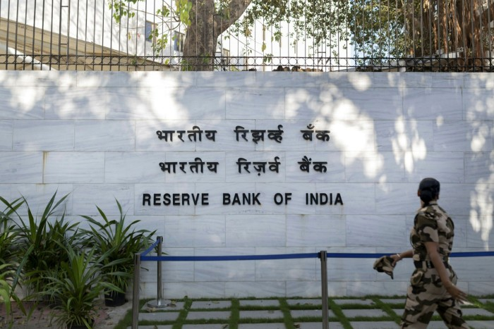 A police officer walks past the Reserve Bank of India in Mumbai