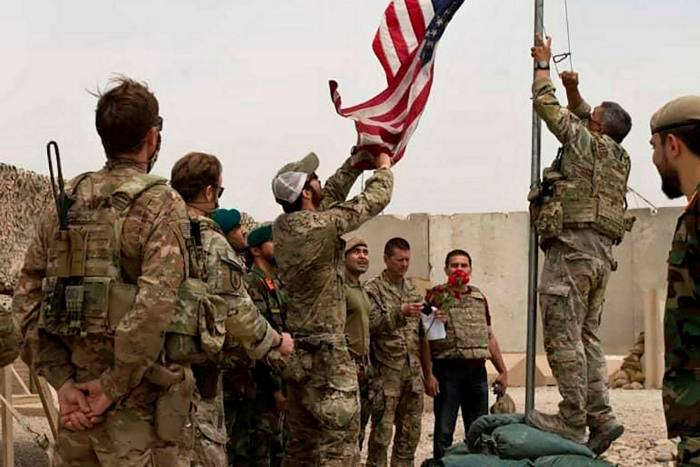 A handover ceremony from the US army to the Afghan national army, in Helmand province, south Afghanistan, in May